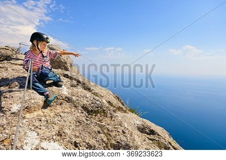 Little Active Child Sit On Mount Top. Look At Amazing Sea Landscape. Family Travel Adventure, Hiking