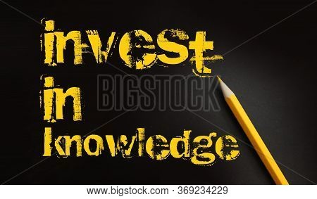Invest In Knowledge Words On Blackboard And Yellow Pencil Besides. Inspirational Motivational Quote.