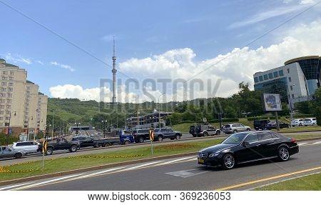 Almaty, Kazakhstan - June 1, 2020: Kok Tobe Telecommunication Tower And Buildings Along Dostyk Avenu