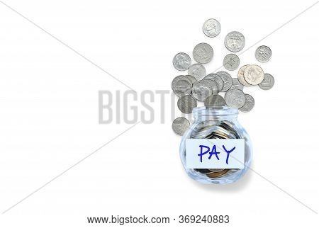 International Money Coins In Glass Bottle Are Overflow Isolated On White Background With Copy Space.