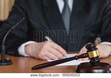 Lawyer And Court. Judge Hits The Table With Hammer. In The Courtroom, The Judge Convicted Lawyer. Ju