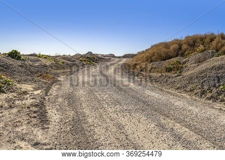 Off-road Street At A Bumpy Scenery In Sunny Ambiance
