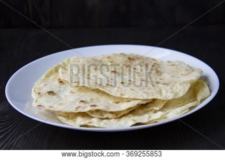 Delicious Pita Bread Made At Home In A Pan. Thin Pita Bread On A White Plate