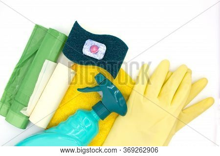 Bottles With Detergents, Brushes And Sponges On White Background. Colorful Cleaning Products. Home C