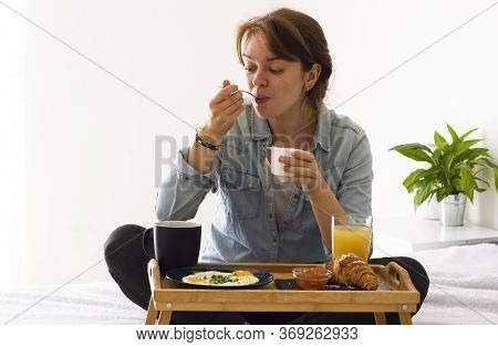 Morning Breakfast Meal Woman Eating Healthy Yoghurt And Fruit In Bed While Happy And Smiling. Breakf