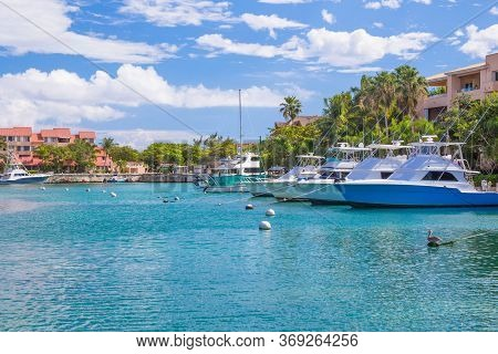 Harbor / Marina In Puerto Aventuras With Boats On A Sunny Day. The Beautiful And Popular Coastal Cit