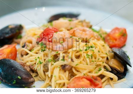 Spaghetti Pasta With Shrimp, Mussels, Tomatoes And Cheese, Close-up, Side View. Tasty, Traditional F