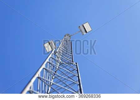 Big And High Floodlights Against Blue Sky