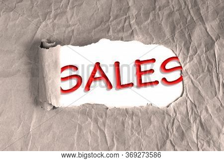 Word Sales On Torn Brown Grunge Paper Background. Marketing Strategy, Different Trajectories In Case