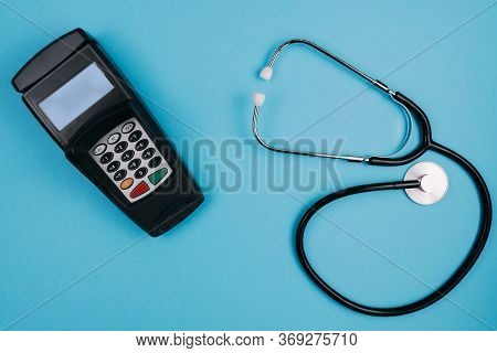 Cost And Payment For Medical Treatment Or Copay Concept, Above Shot Of Stethoscope And Credit Card R