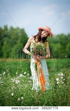 Young woman with a bouquet of wildflowers