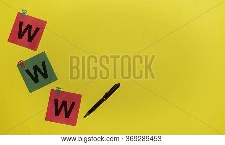 Www - World Wide Web Inscription Written On Red And Green Stickers On Yellow Background