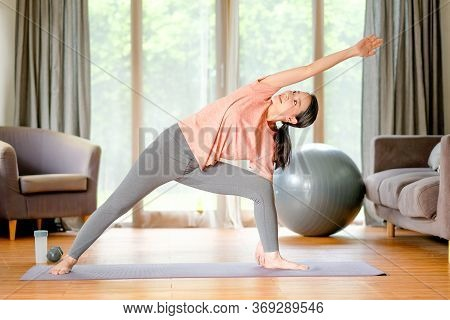 Beautiful Women Doing Yoga With Different Posture And She Look Happy And Relax In Living Room. Conce