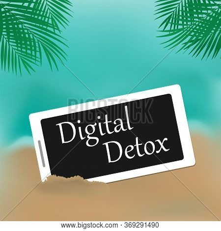 Phone In The Sand, The Inscription Digital Detox On The Screen. The Concept Of A Digital Detox. The