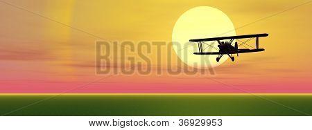 Biplan By Sunset