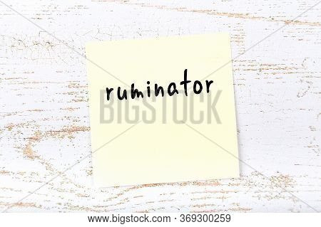 Yellow Sticky Note On Wooden Wall With Handwritten Inscription Ruminator