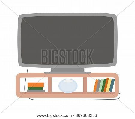 Plasma On Brown Wood Stand With Collection Of Books, Broad Tv Screen For Watching Movies. Wide Monit