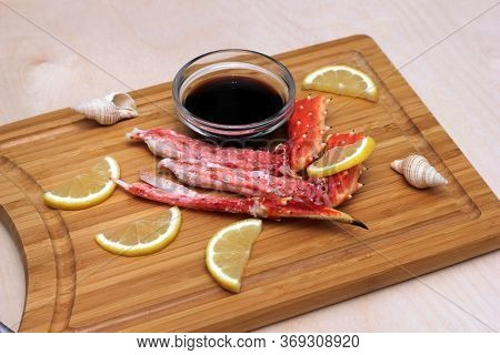 Crab Meat And Lemon On A Wooden Chopping Board Next To Soy Sauce In A Clear Glass Bowl. Boiled Crab.