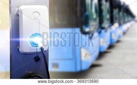 Blue Tourist Buses On Parking And Power Supply For Electric Car Charging. Electric Car Charging Stat