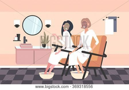 Beautiful Women Applying Face Masks And Foot Basin With Soap Water Girls In Bathrobes Relaxing Skinc