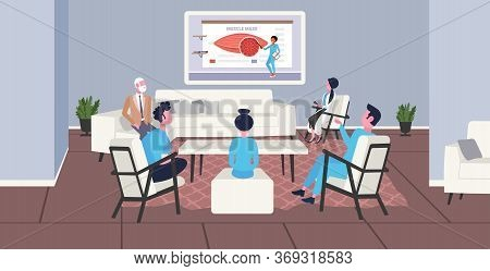Doctors Team Watching Online Tv Presentation About Human Muscles Anatomy Muscle Mass Healthcare Conc