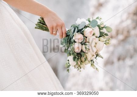 Beautiful Bride Is Holding A Wedding Colorful Bouquet. Beauty Of Colored Flowers. Close-up Bunch Of