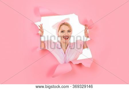 Through Paper. Woman Through Hole In Paper. Pin Up Woman Looking Through Paper. Surprised Woman Look