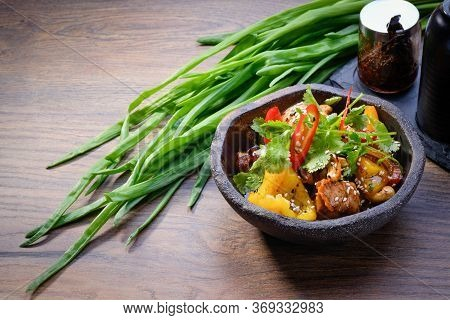 Wok Chicken With Vegetables In A Bowl On Wooden Table Background. Asian Wok With Chicken, Bell Peppe