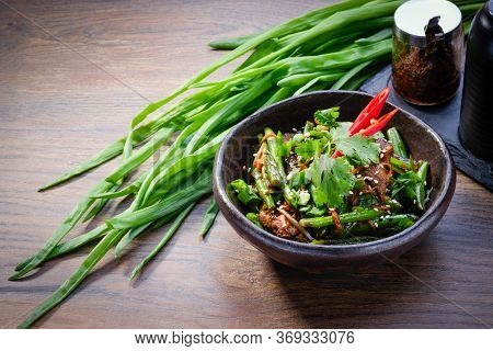 Wok Beef With Vegetables In A Bowl On Wooden Table Background. Asian Wok With Beef, Bell Peppers, Nu