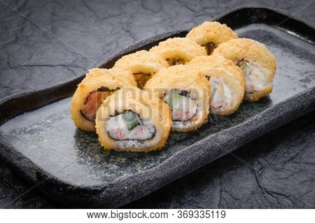 Sushi Set Served On Dark Background. Tempura Maki. Baked Maki Roll, Philadelphia Maki With Masago, S