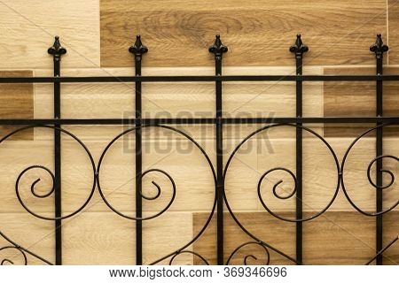 Forged Metal Fence With A Beautiful Retro Pattern. Forged Fence With Artistic Forging. Decorative El