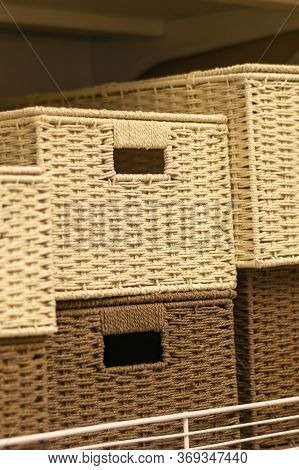 Stack Of White Wicker Baskets Made Of Twigs. Light And Dark Vine In Wicker Boxes. Interior For Stora