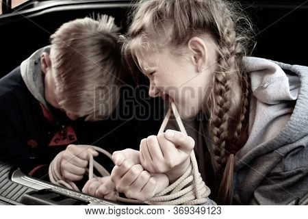 Abduction Of Children. Brother And Sister Tied With A Rope In The Trunk Of A Car. Children Captive H