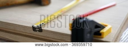 Close-up Of Carpenter Tools And Instruments For Joinery Work. Wooden Plank Fixing In Vise, Measuring