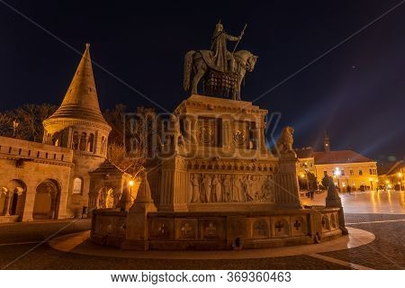 Budapest, Hungary - Feb 8, 2020: Equestrian Statue Of King St. Stephen At Holy Trinity Square At Nig