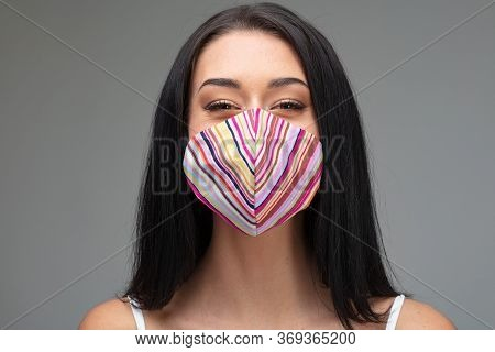 Happy Young Woman Wearing A Colorful Face Mask