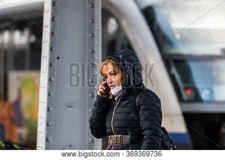 Woman Using Cell Phone On The Train Platform At Bucharest North Railway Station (gara De Nord Buchar