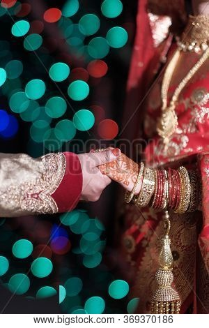 Close Up Of Indian Bride And Groom Holding Hand