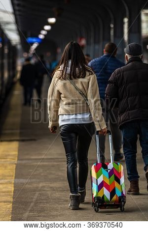 Young Woman Carrying Luggage On The Train Platform At Bucharest North Railway Station (gara De Nord
