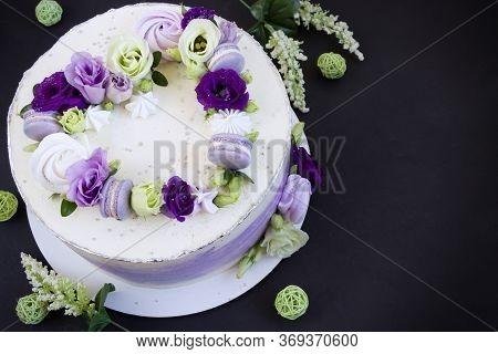 Beautiful Purple Cake Decoraited Of  Fresh Flowers, Macaroons And Meringue. Heart Cake. Love Concept