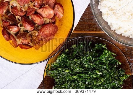 Sliced Smoked Sausage With Onions, Rice And Cabbage  On Wood Background. Snack Appetizer Calabrese S