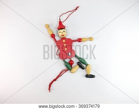 Puppet Old Wood Green And Red Puppet Dolls On A White Background. Images For Commercial User.