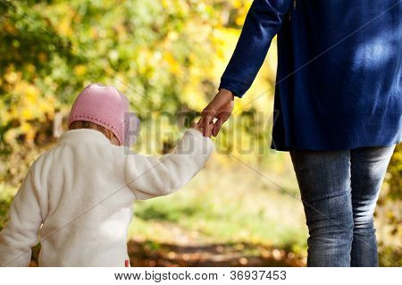 Mother And Daughter Are Holding Hands
