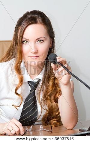 Business Theme:  Portrait Of Successful  Businesswoman With Speakerphone In An Office Environment. M