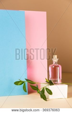 Bottle With Perfume On A Geometric Background