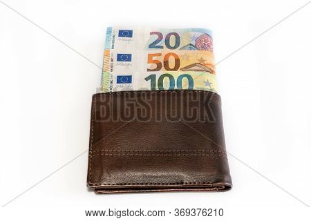 Top View Of Brown Genuine Leather Wallet With Banknotes Inside Isolated On White Background. High Qu