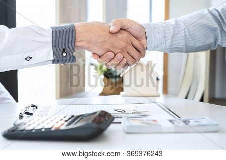 Finishing To Successful Deal Of Real Estate, Broker And Client Shaking Hands After Signing Contract