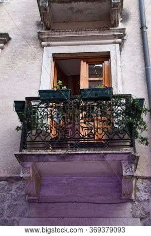 Small Balcony With Wrought Iron Railings In A Historic Building In One Of The Mediterranean Cities W