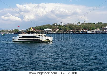 Ferry In Bosphorus In Istanbul City View. Sea Transportation And Passenger Ferry Sailing