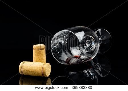Red Wine In A Glass On A High Leg On A Black Background